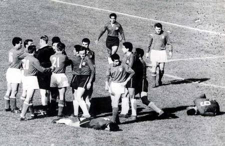 World Cup Finals, 1962. Santiago, Chile. 2nd June, 1962. Italy 0 v Chile 2.  English referee Ken Aston tries to bring order after fighting broke out between Italian and Chilean players during their group two match dubbed as